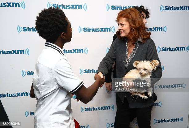 Actor Caleb McLaughlin talks with actress Susan Sarandon duing SiriusXM's 'Town Hall' with the cast of Stranger Things on SiriusXM's Entertainment...