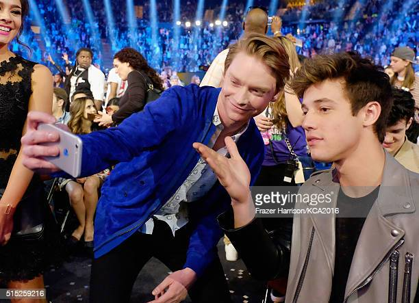 Actor Calum Worthy takes a selfie with internet personality Cameron Dallas at Nickelodeon's 2016 Kids' Choice Awards at The Forum on March 12 2016 in...