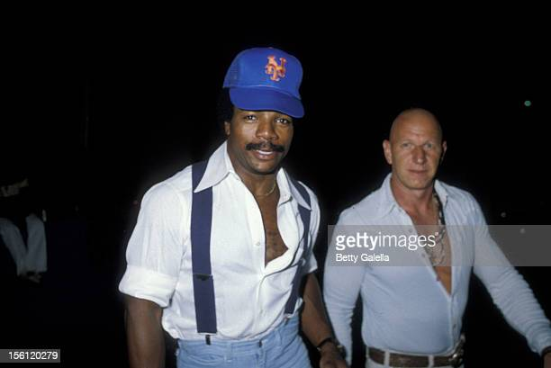 Actor Carl Weathers and guest attending Birthday Party for Jacqueline Bisset on September 13 1979 at Flipper's Roller Boogie Palace in West Hollywood...