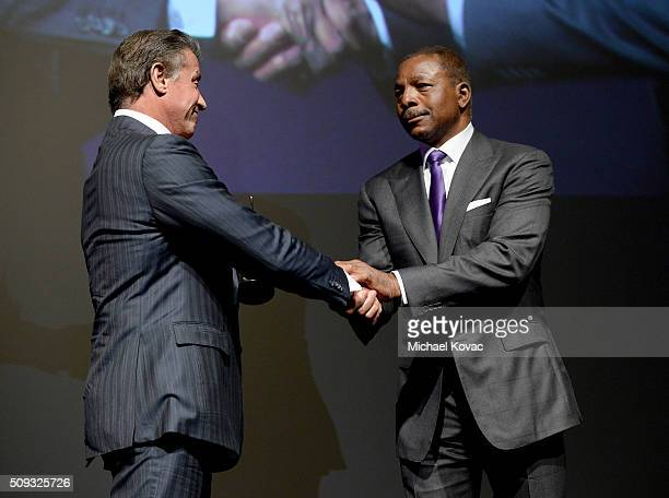 Actor Carl Weathers presents actor Sylvester Stallone with the Montecito Award onstage at The Santa Barbara International Film Festival on February 9...