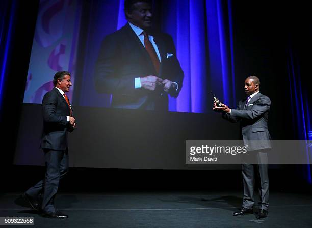 Actor Carl Weathers presents the Montecito Award to Actor Sylvester Stallone at the Arlington Theater at the 31st Santa Barbara International Film...