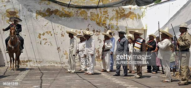 Actor Carlos Maldonado represents Mexican heroe Emiliano Zapata during a performance for the anniversary of his death in Chinameca community, Morelos...