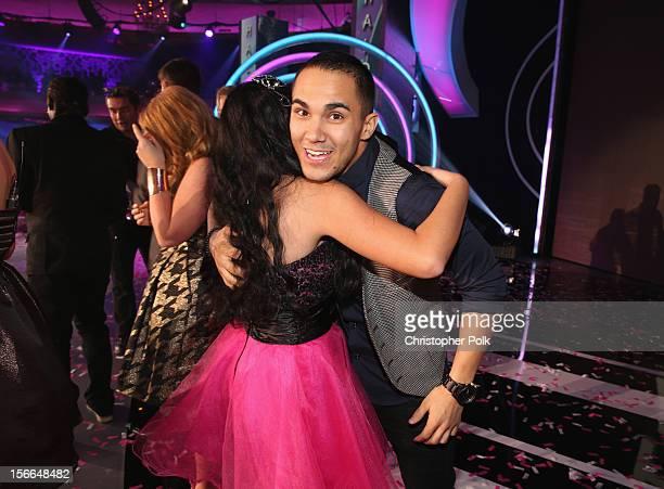 Actor Carlos Pena Jr and 2012 HALO Award honoree Kylie Lan Tumiatti pose onstage at Nickelodeon's 2012 TeenNick HALO Awards at Hollywood Palladium on...
