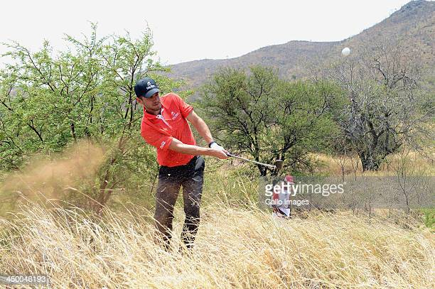 Actor Carmine Giovinazzo plays out of the grass during Round 1 of the Gary Player Invitational presented by CocaCola at The Lost City Golf Course on...