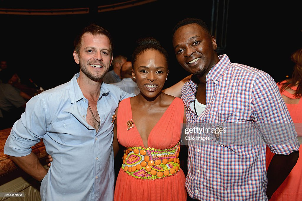 Actor Carmine Giovinazzo, TV and radio personality Unathi Msengena and radio personality Thomas Msengena attend the official welcome function ahead of the Gary Player Invitational presented by Coca-Cola at The Palace Hotel and The Lost City Golf Course on November 14, 2013 in Sun City, South Africa.