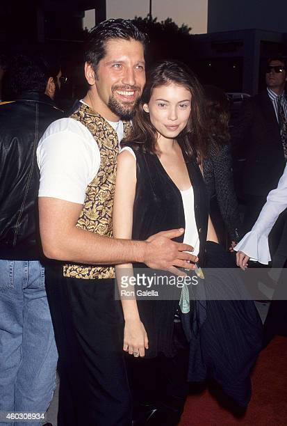 Actor Carmine Zozzora and wife actress Jane March attend the Indecent Proposal Beverly Hills Premiere on April 6 1993 at the Samuel Goldwyn Theatre...