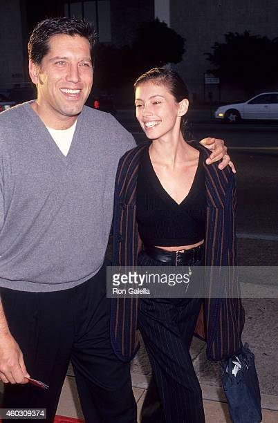 Actor Carmine Zozzora and wife actress Jane March attend the Renaissance Man Hollywood Premiere on May 31 1994 at the Cinerama Dome Theatre in...