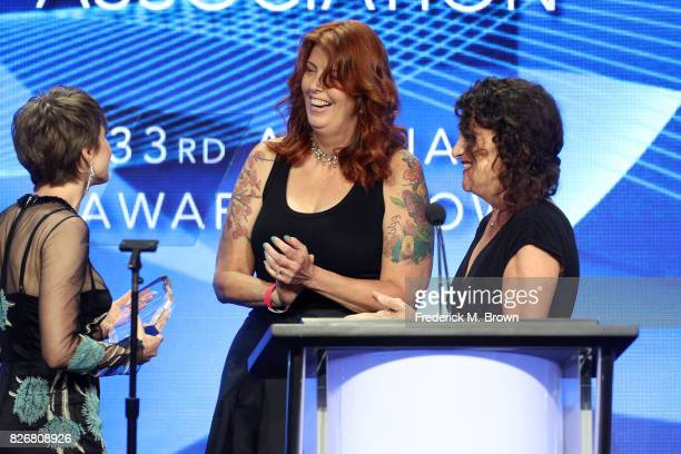 Actor Carrie Coon accepts the award for 'Individual Achievement in Drama' for 'The Leftovers' and 'Fargo' from TCA Board Member, Maureen Ryan and...