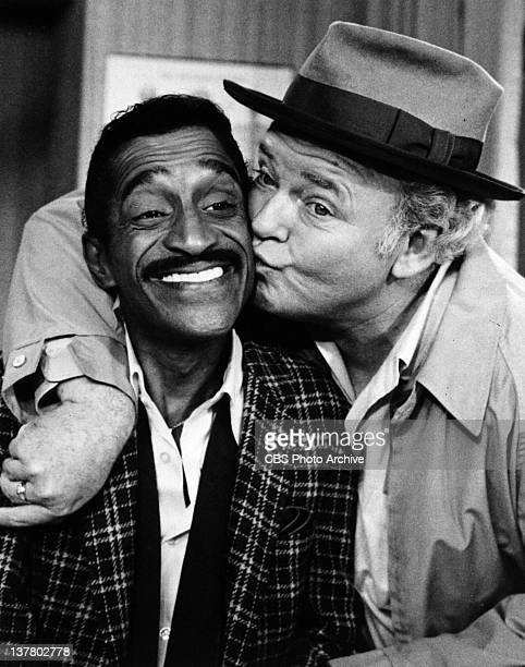 """Actor Carroll O'Conner, playing character Archie Bunker, kisses special guest Sammy Davis Jr. On the CBS television comedy,""""All In The Family"""" in..."""