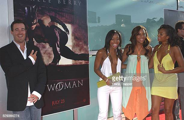 Actor Carson Daly and pop group Misteeq arrive at the world premiere of Catwoman in Los Angeles