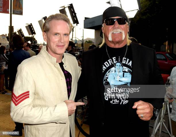 Actor Cary Elwes wrestler Hulk Hogan arrive at the premiere of HBO's 'Andre The Giant' at the Cinerama Dome on March 29 2018 in Los Angeles California
