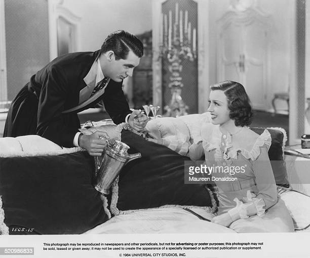 Actor Cary Grant and Frances Drake in a scene from the film 'Ladies Should Listen' 1934