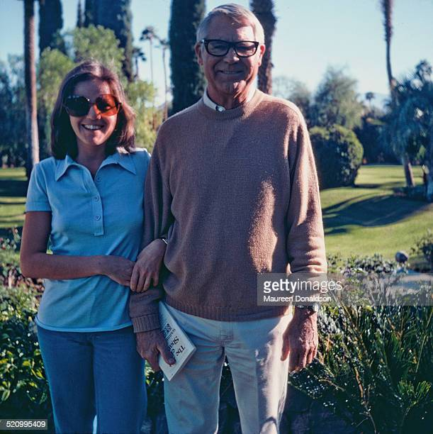 Actor Cary Grant arm in arm with a woman circa 1978