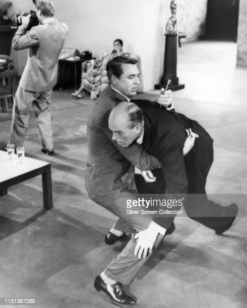 Actor Cary Grant as Roger O Thornhill is framed for the murder of Philip Ober as Lester Townsend in the film 'North by Northwest' directed by Alfred...
