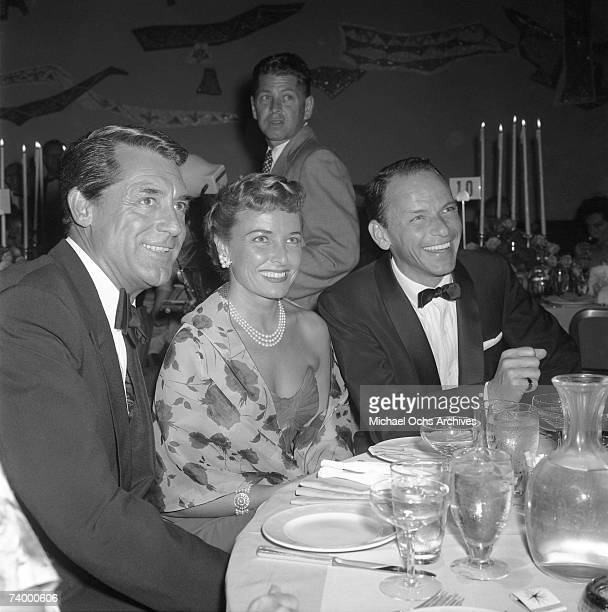 Actor Cary Grant Betsy Drake and pop singer Frank Sinatra attend the Stanley Kramer Party on June 25 1957 in Los Angeles California