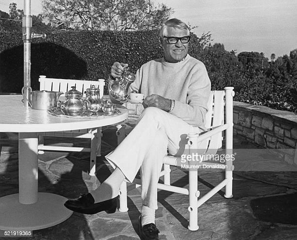 Actor Cary Grant having tea al fresco circa 1980