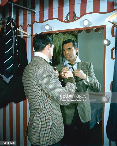 Actor Cary Grant in his dressing room circa 1955 In the background is the 1941 painting 'Flower Vendor ' by Diego Rivera owned by Grant
