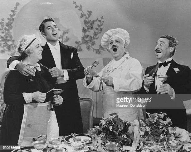 Actor Cary Grant joins the catering staff in a song in a scene from one of his films circa 1935