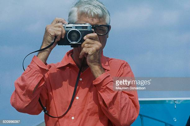 Actor Cary Grant takes a picture, circa 1978.