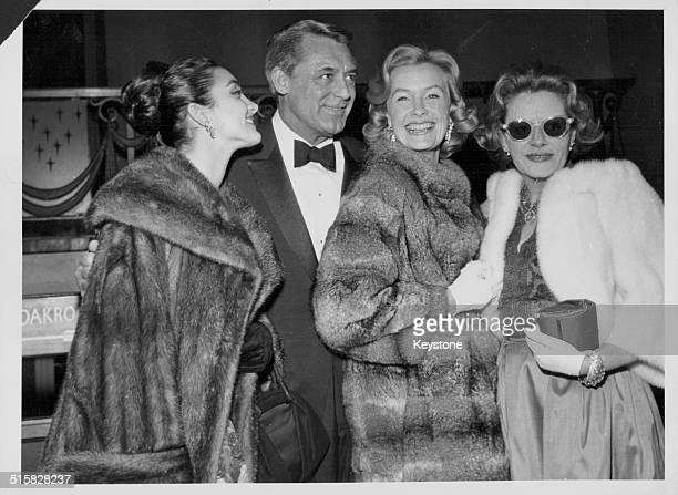 Actor Cary Grant with author Fleur Cowles and actresses Kamala Devi and Dina Merrill at the premiere of the film 'Operation Petticoat' London January...
