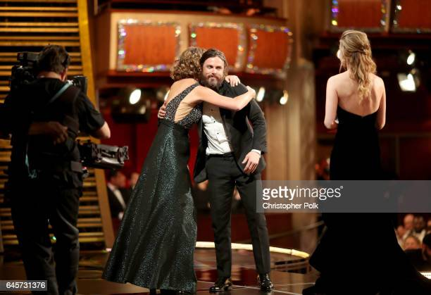 Actor Casey Affleck accepts the Best Actor award for 'Manchester by the Sea' from actor Brie Larson onstage during the 89th Annual Academy Awards at...