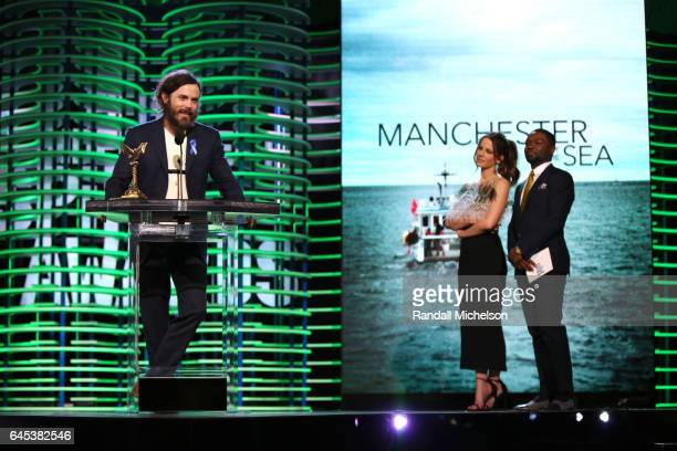 Actor Casey Affleck accepts the Best Male Lead award for 'Manchester by the Sea' from actors Kate Beckinsale and David Oyelowo onstage during the...
