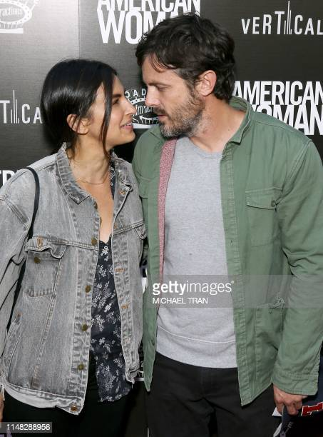 US actor Casey Affleck and girlfriend US actress Floriana Lima attend the premiere of Roadside Attraction's American Woman at the ArcLight in...