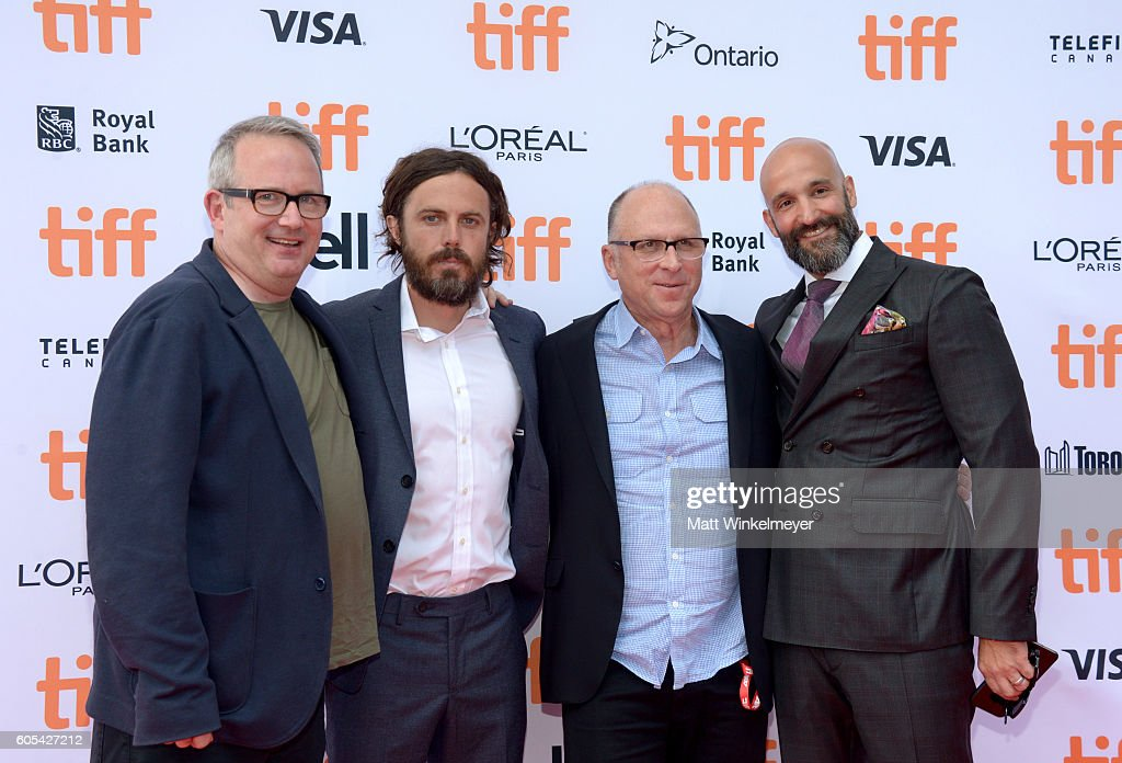 Actor Casey Affleck (2nd L) and Jason Ropell (R) attend the 'Manchester by the Sea' premiere during the 2016 Toronto International Film Festival at Princess of Wales Theatre on September 13, 2016 in Toronto, Canada.