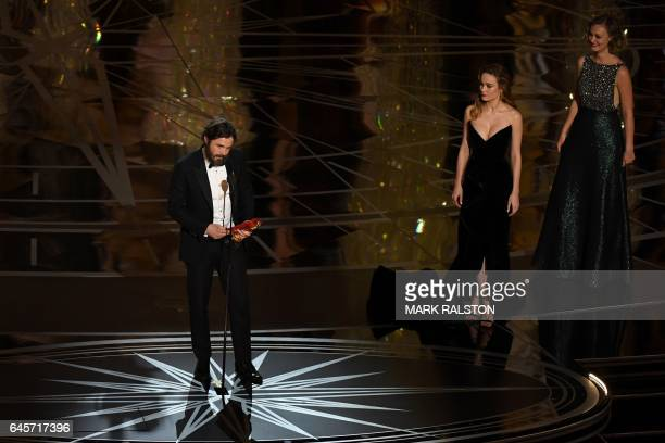 US actor Casey Affleck delivers a speech on stage next to actress Brie Larson after he won the Best Actor award in 'Manchester By The Sea' at the...