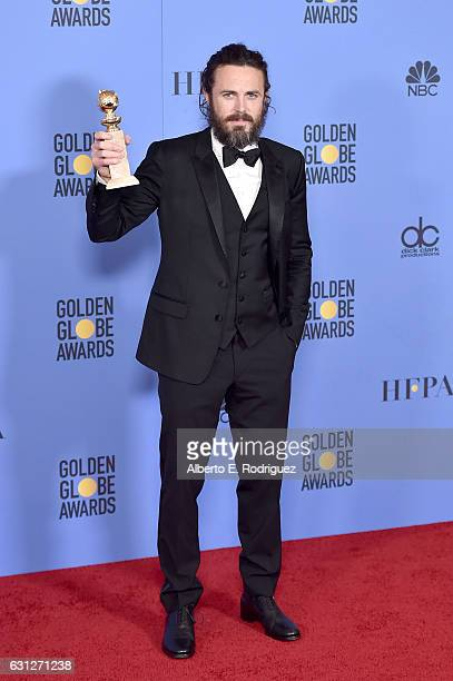 Actor Casey Affleck poses in the press room during the 74th Annual Golden Globe Awards at The Beverly Hilton Hotel on January 8 2017 in Beverly Hills...