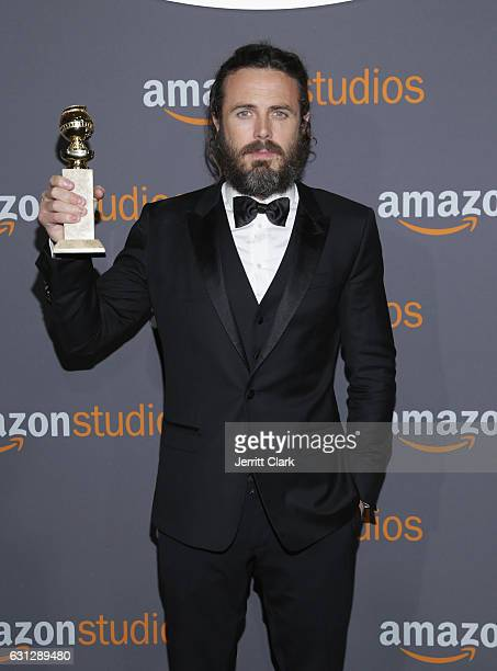 Actor Casey Affleck poses with his award for Best Actor in a Motion Picture - Drama for his role in 'Manchester by the Sea' during the Amazon Studios...