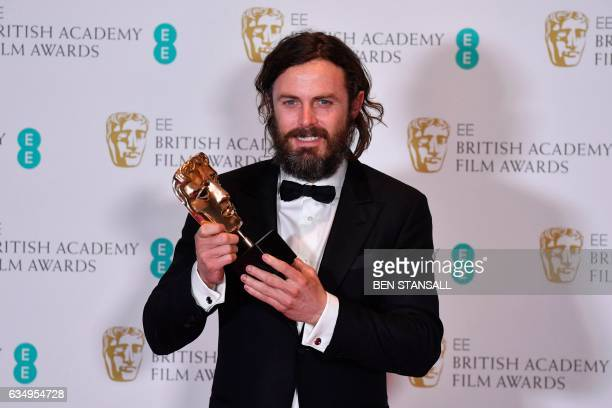 TOPSHOT US actor Casey Affleck poses with the award for a Leading Actor for his work on the film 'Manchester by the Sea' at the BAFTA British Academy...