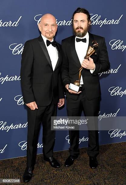 Actor Casey Affleck poses with the Desert Palm Achievement Award and actor Ben Kingsley during the 28th Annual Palm Springs International Film...