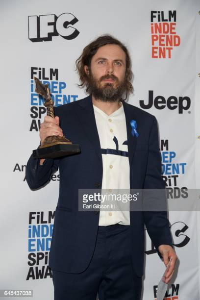 Actor Casey Affleck, winner of the Best Male Lead award for 'Manchester by the Sea' poses in the press room during the 2017 Film Independent Spirit...