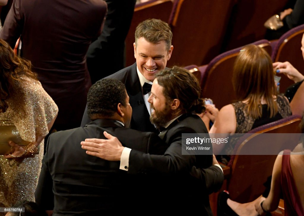 Actor Casey Affleck (R) wins Best Actor for 'Manchester by the Sea' with actor/director Denzel Washington (L) and actor/producer Matt Damon (C) during the 89th Annual Academy Awards at Hollywood & Highland Center on February 26, 2017 in Hollywood, California.