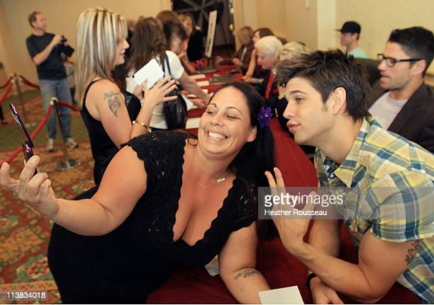 Actor Casey Deidrick with the daytime soap Days Of Our Lives poses for a photo with a fan during a book signing event at Denver Mariott South on May...
