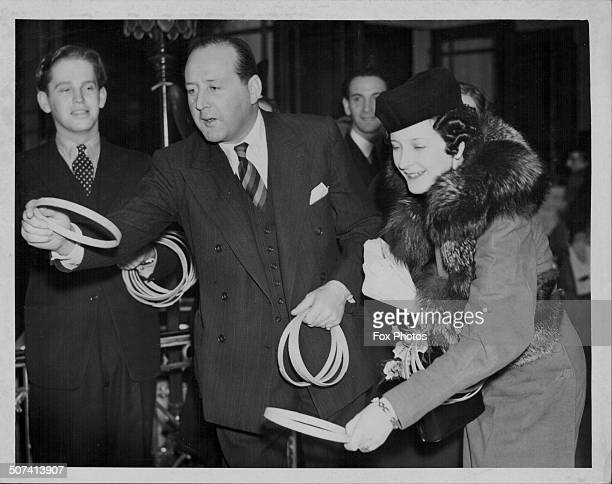 Actor Cecil Parker and his wife Lady Parker playing a hoopla game at the United Charities Christmas Fair December 6th 1939