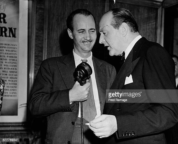 Actor Cecil Parker being interviewed by Douglas Willis of the BBC at the premiere of the film 'Under Capricorn' at Warner's Theatre London 1949