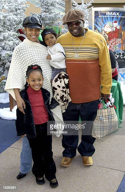Actor Cedric The Entertainer and wife Lorna son Croix and daughter Amber attend the premiere of the IMAX animated film Santa Vs The Snowman 3D at the...