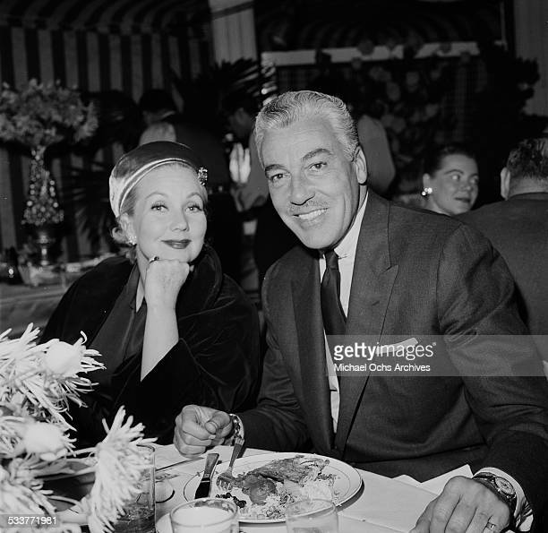 Actor Cesar Romero and Ann Sothern attend an event in Los AngelesCA