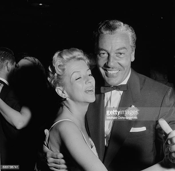 Actor Cesar Romero and Ann Sothern dance as they attend Sammy Davis Jr performing at Ciro's in Los AngelesCA