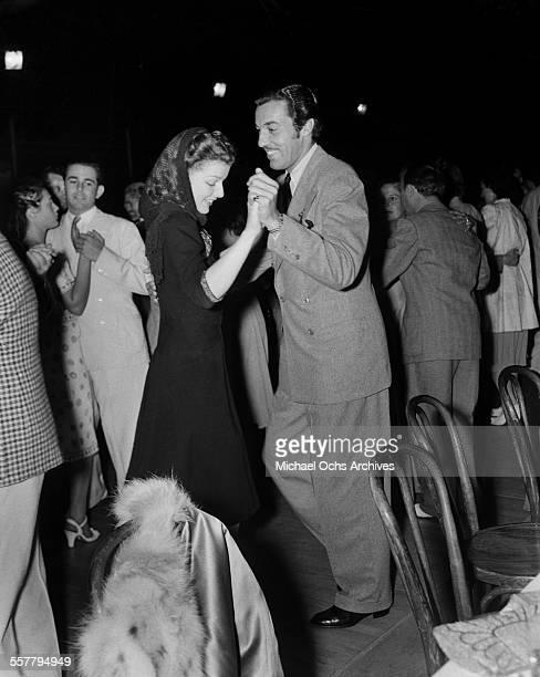 Actor Cesar Romero dances with actress Ann Sheridan in Los Angeles California