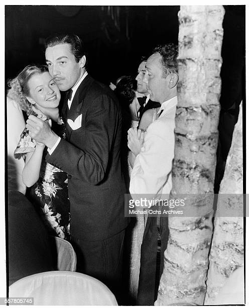 Actor Cesar Romero dances with Virginia Bruce during an event in Los Angeles California