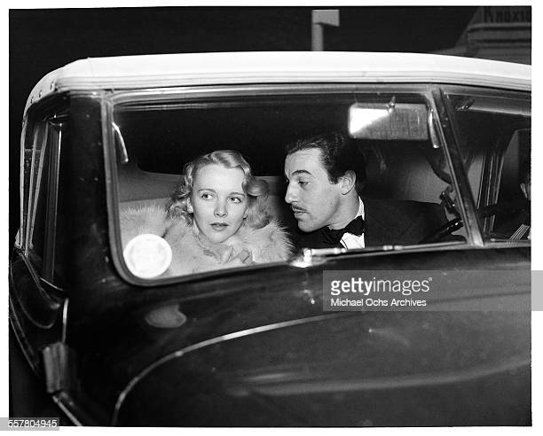 Actor Cesar Romero drives with Virginia Bruce to an event in Los Angeles California