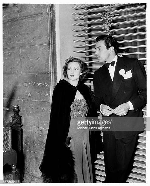 Actor Cesar Romero stands with actress Virginia Bruce in Los Angeles California