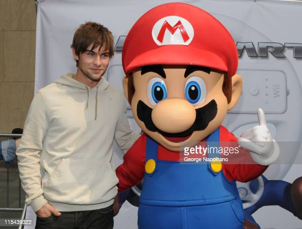 Actor Chace Crawford and Super Mario at the launch of Mario Kart Wii on April 26 2008 at the Nintendo World in New York City