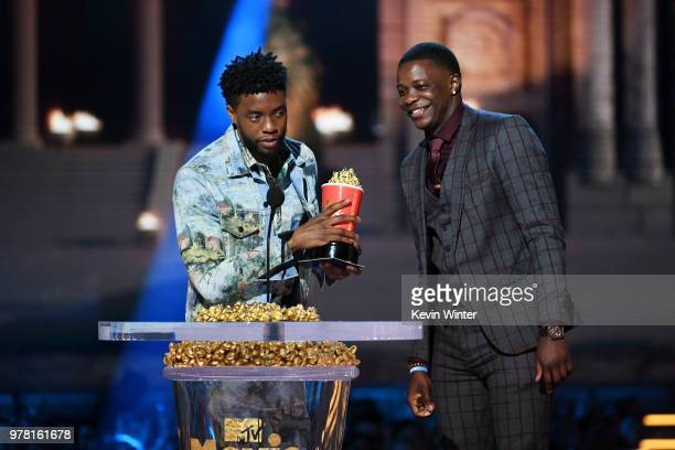 Actor Chadwick Boseman winner of the Best Hero award for 'Black Panther' presents his trophy to James Shaw Jr onstage during the 2018 MTV Movie And...