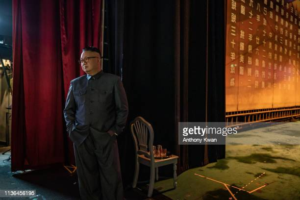 Actor Chan Hung Chun dressed as North Korean Leader Kim Jongun prepares in backstage during a rehearsal of a Cantonese opera Trump on Show on April...