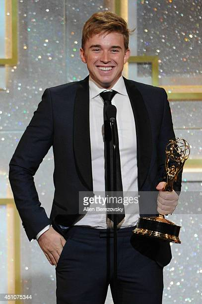 Actor Chandler Massey accepts an Emmy Award onstage during the 41st Annual Daytime Emmy Awards at The Beverly Hilton Hotel on June 22 2014 in Beverly...
