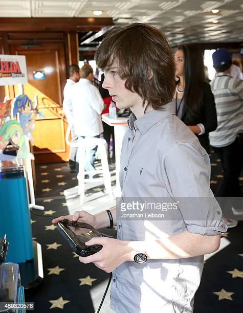 Actor Chandler Riggs attends The Nintendo Lounge on the TV Guide Magazine yacht during ComicCon International 2015 on July 10 2015 in San Diego...